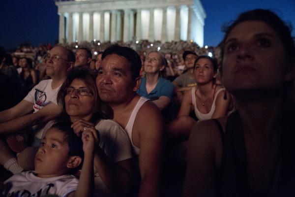 Watching the fireworks is a tradition for Ramon Romero of Leesburg, Va., wife Elisa and son Relson. The family emigrated from El Salvador more than 20 years ago