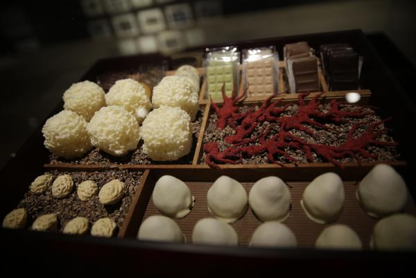 The museum exhibit includes a replica of a box of 17 different kinds of elaborately produced chocolate bon-bons served at the end of each multi-course meal at El Bulli.