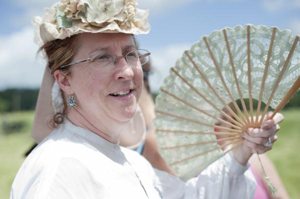 Leeanne Boles, of California, fans herself from the sidelines of the battlefield. Her fianceŽ was portraying a Confederate lieutenant.