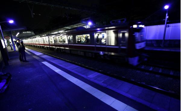 Alarmed by a rise in people jumping to their deaths in front of trains, Japanese railway operators are installing special blue lights above station platforms they hope will have a soothing effect and reduce suicides, Oct. 14, 2009. (Itsuo Inouye/AP)