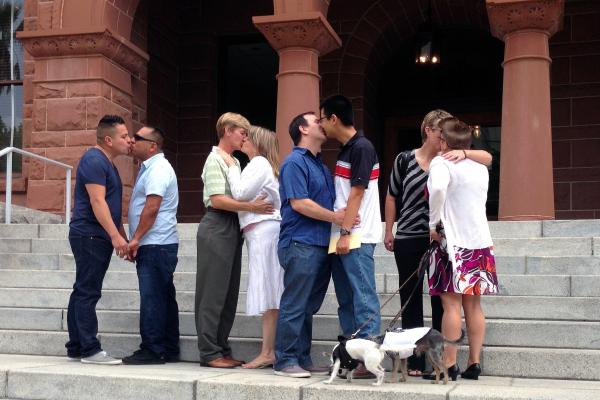 Couples kiss at the Old Orange County Courthouse in Santa Ana, Calif., earlier this month.