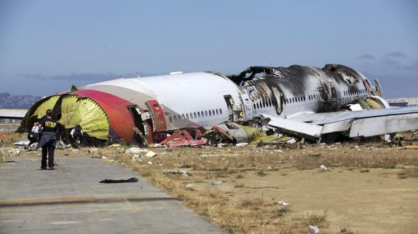 NTSB investigators at the scene of the Asiana Flight 214 crash in San Francisco.