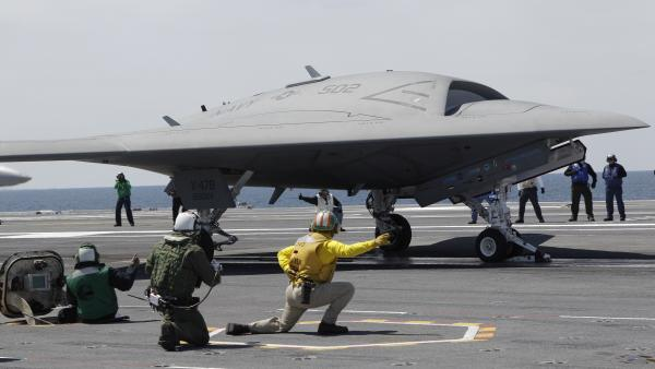 A Navy X-47B drone, seen here last month being launched off the aircraft carrier USS George H. W. Bush, successfully landed on the ship Wednesday, a first.