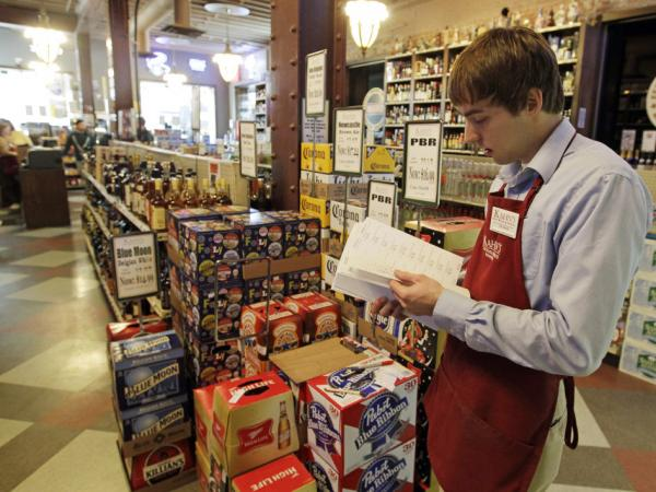 Indiana still has some of the strictest laws governing alcohol sales in the United States, including a prohibition against all carryout alcohol sales on Sundays. Here, Bill Cheek, an employee at Kahn's Fine Wines and Spirits in Indianapolis, puts labels on cases of beer.