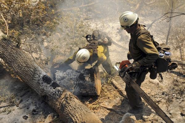 Members of the Entiat Hotshots, based out of central Washington State, work on a spot still burning near Reserve, N.M., Thursday, June 7, 2012. (Brandon R. Oberhardt/U.S. Forest Service via AP)