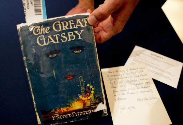 A copy of <em>The Great Gatsby</em> by F. Scott Fitzgerald is displayed at Sotheby's in New York.