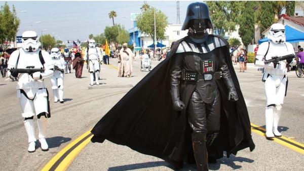 Sam Newcomer, a member of the Southern California Garrison of the 501st Legion, marches as Darth Vader leading his Stormtroopers in the Rosemead Fourth of July parade.