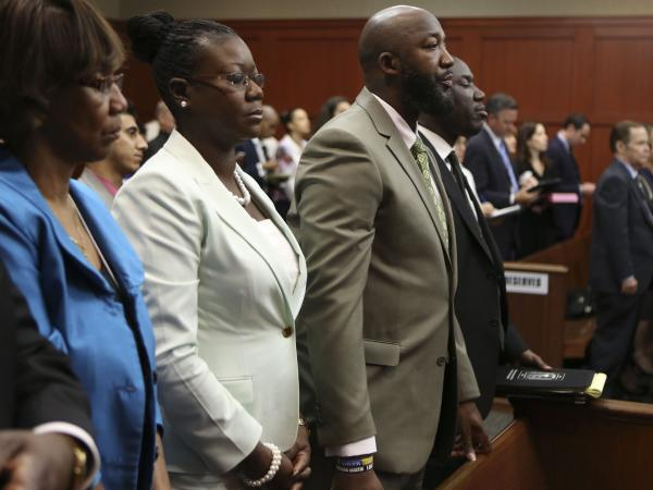 Many families live in dread of standing in the shoes of Trayvon Martin's parents. His mother, Sybrina Fulton (second from left) and father, Tracy Martin, were in court Friday as a Florida jury began its deliberations.