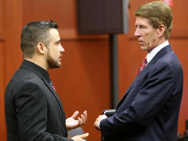 Robert Zimmerman Jr. (left) speaking with defense attorney Mark O'Mara during a pre-trial hearing in May.