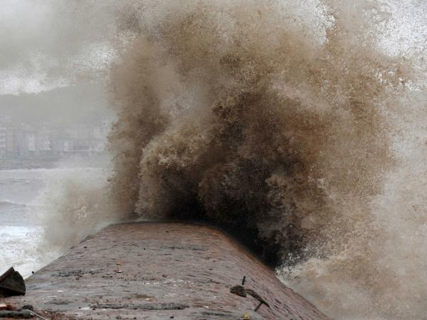 Huge typhoon-driven waves surge up the coastline of Huangqi Peninsula in China's eastern Fujian province on Saturday.