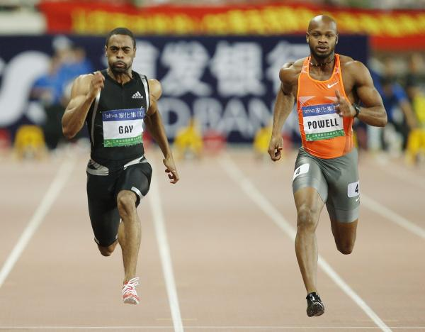 Tyson Gay of the United States, left, and Asafa Powell of Jamaica, right, during their 100 meter race at the 2009 Shanghai Golden Grand Prix, an international track and field event. (Eugene Hoshiko/AP)