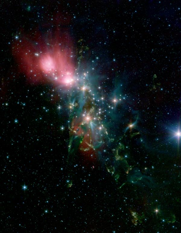 "Located 1,000 light-years from Earth in the constellation Perseus, a reflection nebula called NGC 1333 epitomizes the beautiful chaos of <a href=""http://www.spitzer.caltech.edu/images/1521-ssc2005-24a-Chaotic-Star-Birth"">a dense group of stars being born</a>. Most of the visible light from the young stars in this region is obscured by the dense, dusty cloud in which they formed."