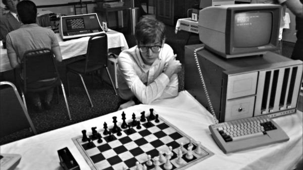 Patrick Riester plays one of the alpha geeks competing in a game-writing tournament in <em>Computer Chess</em>, a willfully odd comedy from mumblecore pioneer Andrew Bujalski.