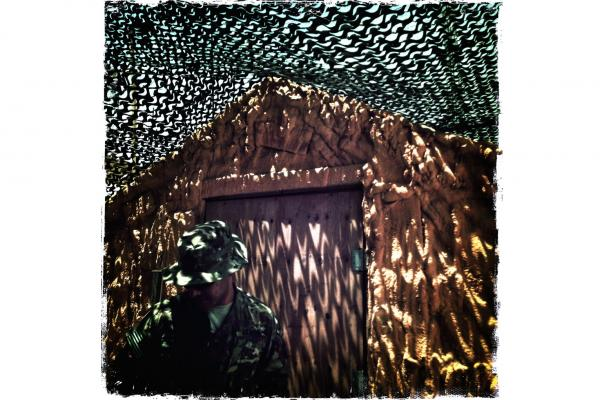 Camouflage netting is a defense against the temperatures that can rise to 120 degrees in Panjwai district of southern Afghanistan.