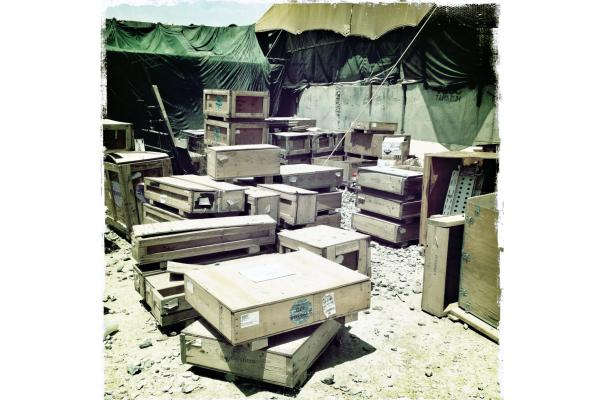 Boxes come and go from the bases at a furious pace, with the retrograde in full swing. The containers are usually turned into furniture by the troops when they are not needed for return shipping.
