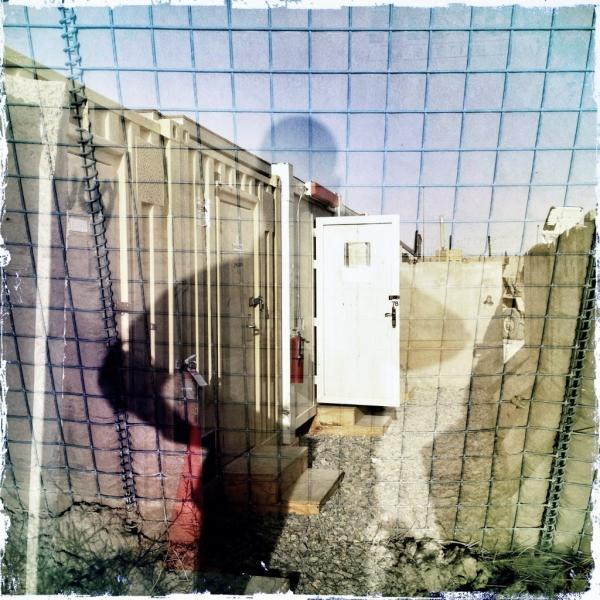 A double exposure and self-portrait at a combat outpost in southern Afghanistan.