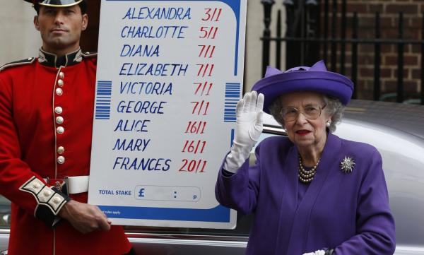 As part of a publicity stunt, people from a bookmakers office dressed as Britain's Queen Elizabeth II, right and a British Guardsman, left, stand with a placard with the odds for the name of the royal baby as they pose for the media outside St. Mary's Hospital exclusive Lindo Wing in London, Wednesday, July 3, 2013. (Lefteris Pitarakis/AP)
