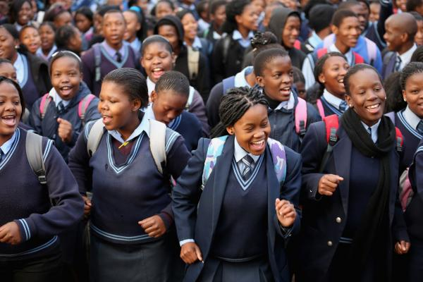 Schoolchildren sing 'Happy Birthday' to former South African President Nelson Mandela at Phefeni High School, opposite Mandela's former home in Soweto Township on Thursday in Johannesburg, South Africa.