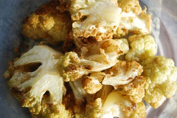 Fried cauliflower, ready to be added to the pot of chicken boiling for maqluba, a favorite family dish.