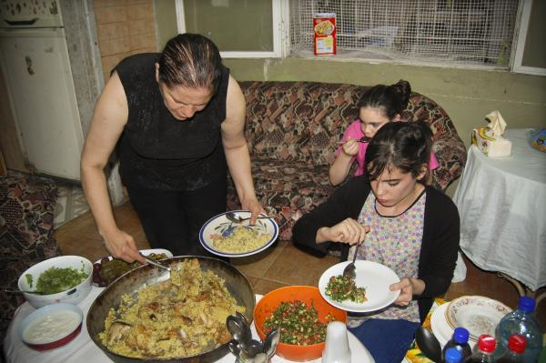 As the cannon sounds for the call to evening prayer, Outteineh's family breaks their fast.
