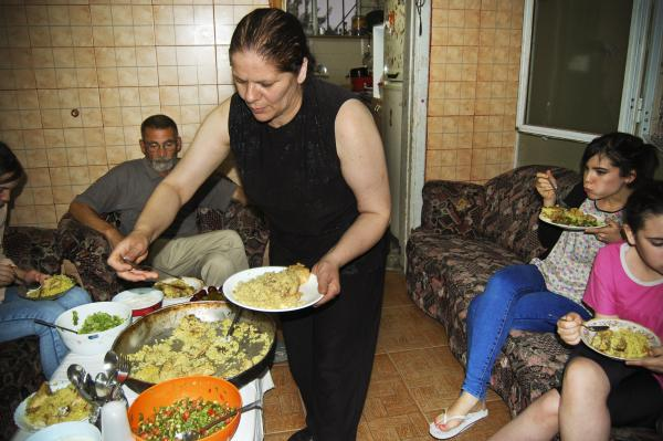 Jehad Outteineh (center) observes iftar with her family by serving maqluba, a favorite dish of chicken, cauliflower and rice.