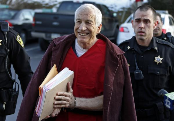 Former Penn State University assistant football coach Jerry Sandusky, center, arrives at the Centre County Courthouse for a post-sentence motion in Bellefonte, Pa., Thursday, Jan. 10, 2013. (Gene J. Puskar/AP)
