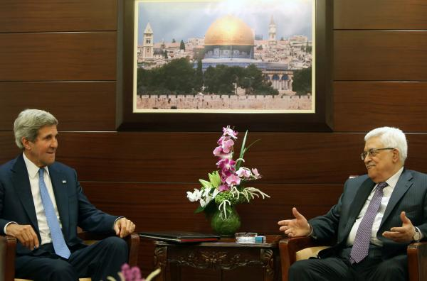 "Secretary of State John Kerry meets with Palestinian President Mahmoud Abbas in Ramallah, West Bank, on Friday. Shortly afterward, Kerry announced a ""basis"" for the Israelis and Palestinians to resume peace negotiations."