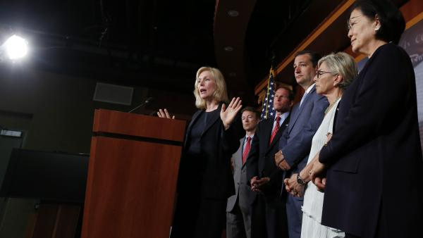 Sen. Kirsten Gillibrand speaks to reporters Tuesday. With her Sens. Rand Paul, R-Ky.,  Richard Blumenthal, D-Conn., Ted Cruz, R-Texas, Barbara Boxer, D-Calif. and Mazie Hirono, D-Hawaii, all of whom have endorsed her bill on military sexual assault.