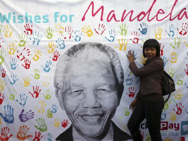 Former South African President Nelson Mandela has been in a Pretoria hospital since June 8. He's being treated for a life-threatening respiratory infection. Last week he turned 95 and a banner near the hospital drew admirers such as this woman.