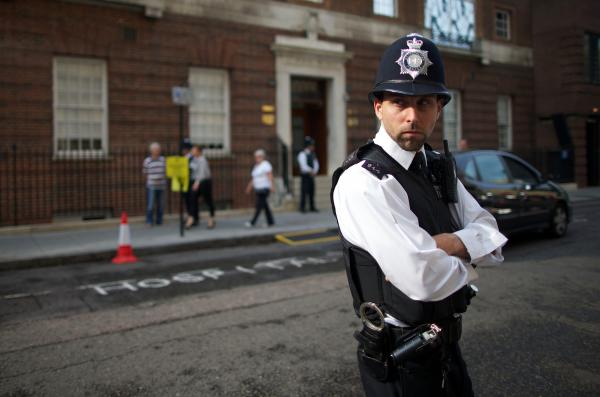 A policeman stands guard outside the exclusive Lindo Wing of St. Mary's Hospital in London earlier Monday.