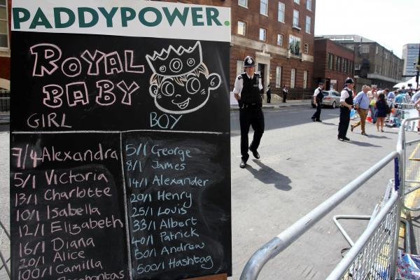 A bookie's board outside the hospital shows odds for the baby's gender and name. The duchess was admitted to the hospital at approximately 6 a.m. local time.