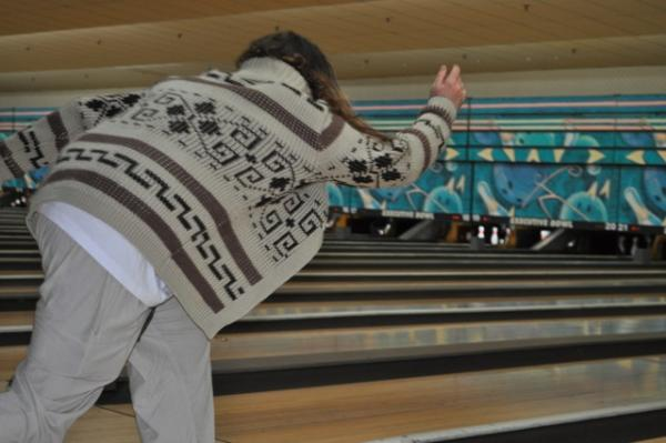 "A participants dressed a Jeff Bridges's character Jeffrey Lebowski (""The Dude"") bowls at the 12th annual Lebowski Fest in Louisville, Kentucky. (Joseph Lord/WFPL)"