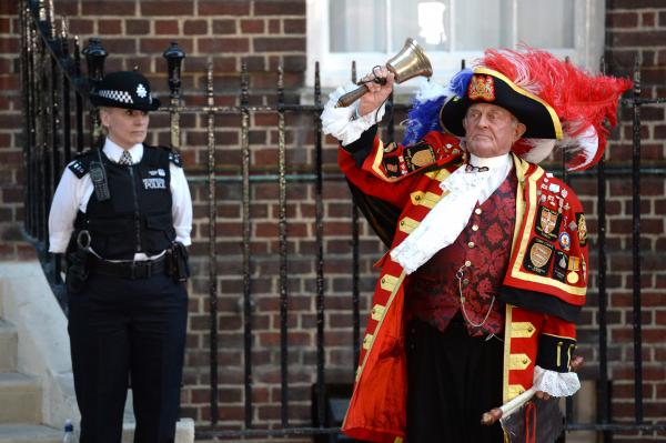 A man dressed as a town crier celebrates the birth announcement at St. Mary's Hospital, where the child was born.