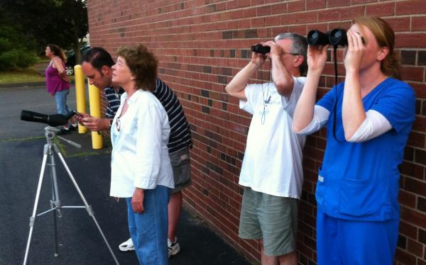 Birdwatchers gather along an industrial stretch of Route 5 in Hamden, Conn. (Max Moran/WNPR)