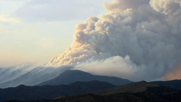 Smoke billows from the Carpenter 1 fire in the Spring Mountains range of Nevada on July 5. As of June 23, more than 27,000 acres have burned.
