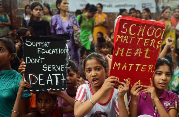 "Indian children and activists shout anti-government slogans on Saturday as they march to parliament demonstrating against the death of 23 children in Bihar state after they ate poisoned ""midday meals."""