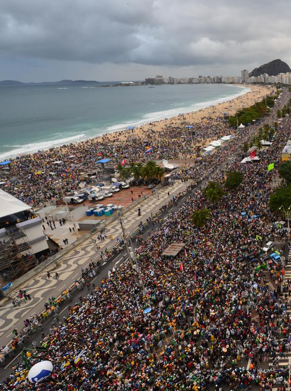Thousands of young people gather at Rio de Janeiro's iconic Copacabana beachfront to welcome Pope Francis to World Youth Day ceremonies. On the fourth day of his visit to Brazil, Francis waded into the country's ramshackle slums and onto the national battle over poverty and corruption.