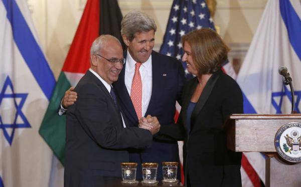 Secretary of State John Kerry stands between Israel's Justice Minister and chief negotiator Tzipi Livni, right, and Palestinian chief negotiator Saeb Erekat, as they shake hands after the resumption of Israeli-Palestinian peace talks, Tuesday, July 30, 2013, at the State Department in Washington. (Charles Dharapak/AP)