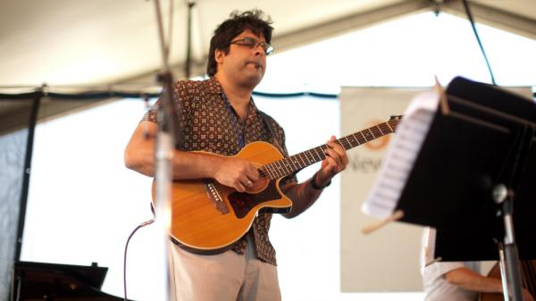 Rez Abbasi performs at the Newport Jazz Festival.