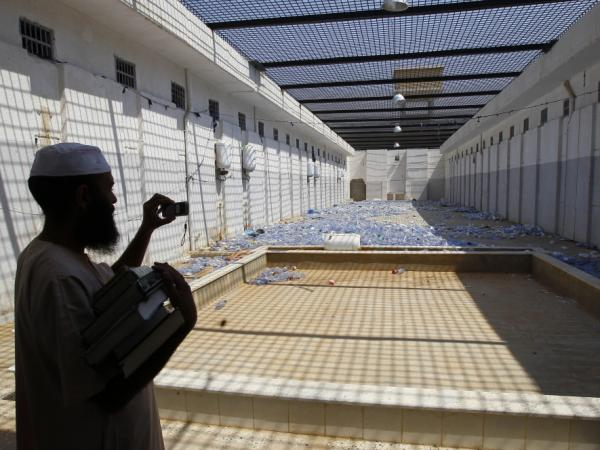 A man photographs the courtyard of Abu Salim prison in Tripoli on Saturday. One of those released from Libya's most notorious prison was American writer and filmmaker Matthew Van Dyke, who had been held in solitary confinement for six months.
