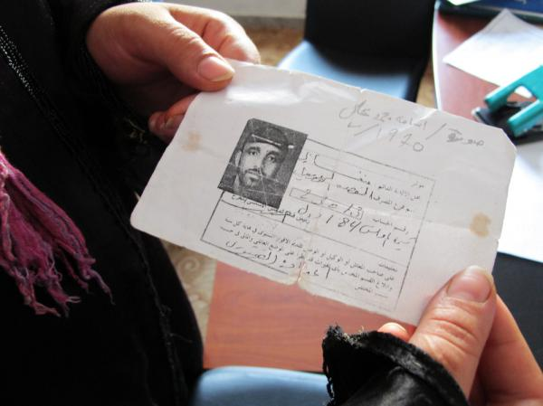 Mona Mohammed Ali holds a copy of her brother's identification card, found in the western town of Zawiya. He traveled to the town before the revolution began and became stuck there. Mohammed believes her brother is dead, but on Monday she came to the Red Crescent office seeking information.