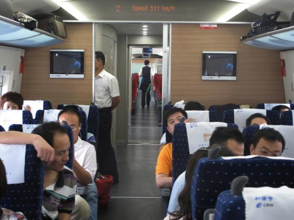 On a recent high-speed rail journey, the train was clearly breaking the 300 kilometer (186 mile) per hour speed limit, according to the speed indicator within the train carriage.