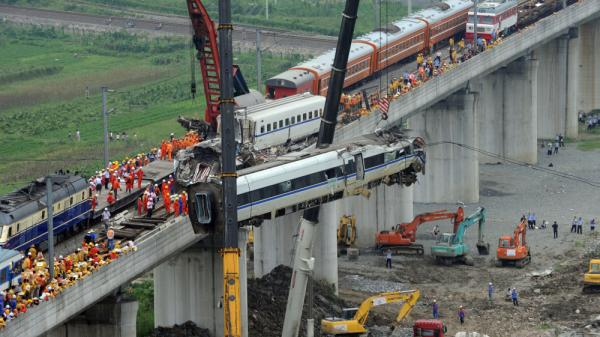 Workers clear the wreckage of a July 23 high-speed-train collision in Wenzhou in eastern China's Zhejiang province. The crash killed 40 people and raised questions about the safety of the country's high-speed-rail network, which the Chinese government has held up as an example of its technological prowess and with which it had hoped to attract overseas buyers.