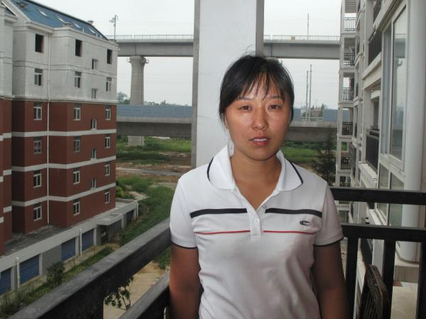 "Sun Miankou didn't know the high-speed rail would pass overhead until they began building the pillars outside her apartment. ""Of course I'm scared,"" she says, but she's also angry. ""Two generations of my family worked to afford the apartment, and now the high-speed rail has been built right on top."""