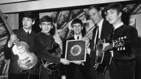 <p>The Beatles, left to right: Paul McCartney, George Harrison, Ringo Starr, producer George Martin, John Lennon.</p>