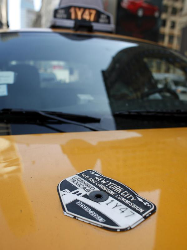 A New York City Taxi & Limousine Commission medallion adorns the hood of a taxi. The value of a medallion has increased 1,000 percent since 1980.