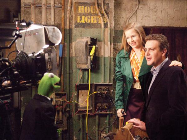 <strong></strong>Kermit the Frog does the backstage-chat thing with Amy Adams and Jason Segel in <em>The Muppets.</em>