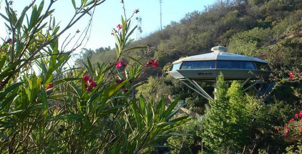 Designed in 1958, architect John Lautner's Chemosphere House perches atop a 29-foot concrete pole on a roughly 45 degree slope in California's Hollywood Hills and is accessible via funicular.