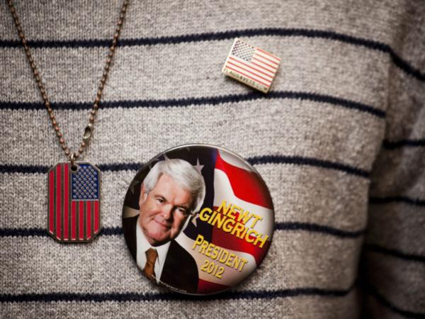 A Gingrich supporter shows off a campaign button at a town hall meeting in New York.