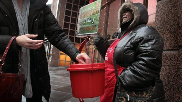 In Chicago: Antionette Levi rings her bell as she solicits donations for the Salvation Army.